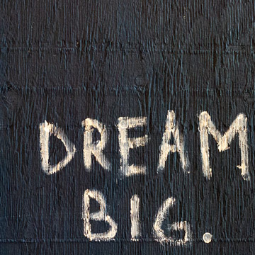 Dream big written on piece of wood